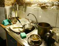 Dirty dishes. Mess in the kitchen needed to be wash royalty free stock photography
