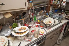 Dirty dishes. Pile of dirty dishes in sink and counter top after a party stock photo