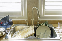 Dirty dishes. Kitchen sink full of dirty dishes Royalty Free Stock Photos