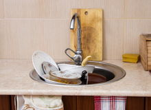 Dirty dishes closeup. Home sink full of dirty dishes Royalty Free Stock Image