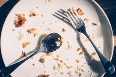 Dirty Dishes with Food Scraps. On wood table Stock Photos
