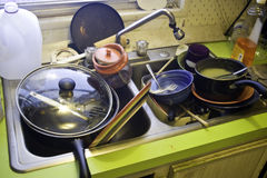 Dirty Dishes in Kitchen Sink. Dirty dishes waiting to be washed in kitchen sink royalty free stock photography