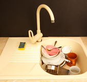 Dirty dishes in kitchen sink Stock Photos