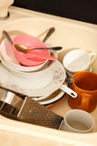 Dirty dishes in kitchen sink. In closeup royalty free stock image
