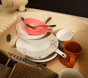 Dirty dishes in kitchen sink Stock Photography