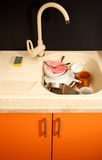 Dirty dishes in kitchen sink Royalty Free Stock Image