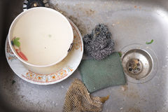 Dirty dishes in kitchen sink. Closeup royalty free stock image