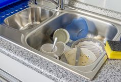 Dirty Dishes in a Kitchen Sink Stock Photos