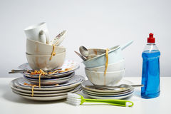 Dirty dishes pile on white background stock image