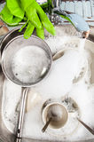 Dirty dishes in a rectangular sink in foam Stock Images