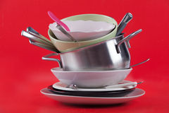 Dirty dishes on red background Royalty Free Stock Photos