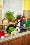 Dirty dishes in the sink after family celebrations. Home cleaning the kitchen. Cluttered dishes in the sink. Housework. Stock Images