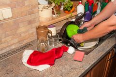 Dirty dishes in the sink after family celebrations. Home cleaning the kitchen. Cluttered dishes in the sink. Housework. Royalty Free Stock Photo