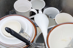 Dirty dishes in sink Stock Photography