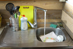 Dirty dishes in the sink Royalty Free Stock Photo