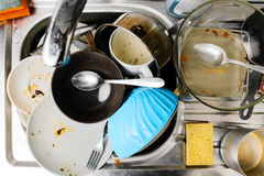 Dirty dishes in a sink Stock Photos
