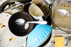 Dirty dishes in a sink Royalty Free Stock Images