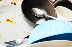 Dirty dishes in a sink Royalty Free Stock Photos