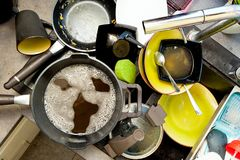 Dirty dishes in sink. A pile of dirty dishes in the sink Stock Photos