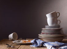 Dirty dishes. On a wooden table royalty free stock images