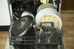 Dirty dishware in dishwasher stock image