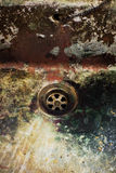 Dirty drain. Old disgusting dirty colourful drain in ancient industry Royalty Free Stock Photo