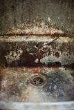Dirty drain. Old disgusting dirty colourful drain in ancient industry Royalty Free Stock Image