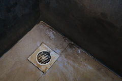 Dirty drain and floor in toilet Royalty Free Stock Photos