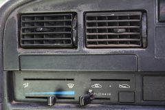 Close up dirty dust air condition vent channel in the old car. f royalty free stock images