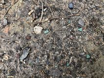 Dirty earth texture with stones and shards royalty free stock photos