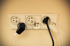 Dirty electric plug in socket for power. Royalty Free Stock Images