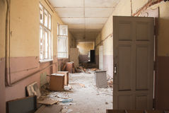 Dirty empty corridor at abandoned school building. Abandoned corridor and destroyed desks and lockers are seen in an old school building Sofia, Bulgaria, May 12 Stock Image