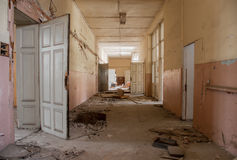 Dirty empty corridor at abandoned school building. Abandoned corridor is seen in an old school building in Sofia, Bulgaria, May 12, 2014. Some of the doors doors Stock Photography