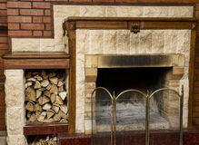 Dirty empty fireplace with firewood Stock Photos