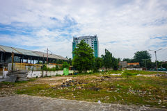 Dirty empty park with trash and cloudy sky as background photo taken in Tanah Abang Jakarta Indonesia Royalty Free Stock Image