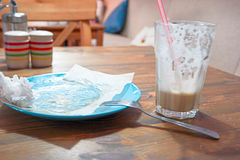Dirty empty plate and half-empty glass of coffee Royalty Free Stock Images