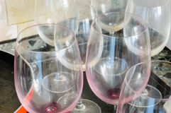 Dirty empty wine glasses and a red pan, after a good dinner,. Are waiting to be washed royalty free stock photos