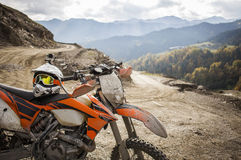 Dirty enduro motorcycle motocross helmet on road Stock Image