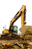 Dirty excavator parked on the construction site Stock Images