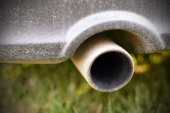 Dirty exhaust pipe auto. Dirty exhaust pipe of a car. Black soot hole Royalty Free Stock Photos