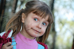 Dirty face. Outdoor portrait of a little girl who got very dirty having walk Stock Photography
