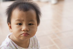 Dirty face of baby after meal Stock Image