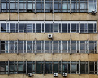 A dirty factory. Dirty old facade with windows of factory Royalty Free Stock Photo