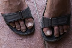 b3867dbb7c3d6 Dirty feet in sandals. Dirty feet of a man descended from the mountains  stock images