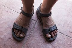 Dirty feet in sandals Stock Photos