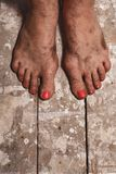 Dirty female feet Royalty Free Stock Images
