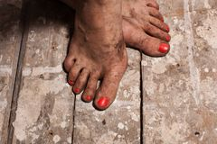 Dirty female feet Stock Photos