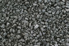 Dirty, fine, gray crushed stone. Dirty, small, gray crushed stone near the road Stock Image