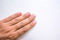 Dirty fingernails with dirt lodged in the nails stock photography