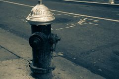 Dirty fire hydrant on the street in vintage style. Dirty fire hydrant on the street in green vintage style Stock Photo